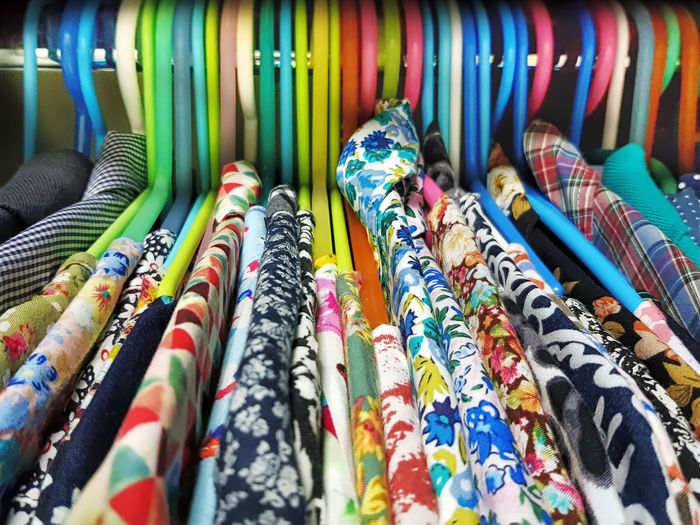 Close-up of multi colored clothes on rack in store