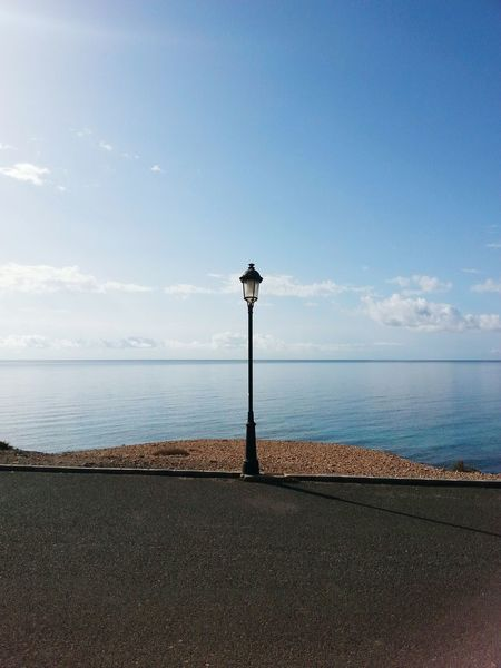 Sea Horizon Over Water Water Tranquil Scene Tranquility Street Light Sky Scenics Calm Nature Cloud Lamp Post Blue Day Outdoors Ocean Canaryislands Beauty In Nature Shore Coastline