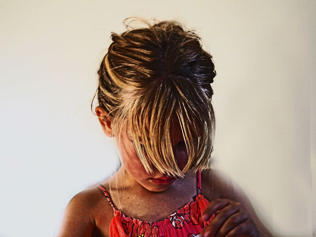 Concentration Adult Blond Hair Brown Hair Child Hair Hair Bun Hairstyle Headshot Human Hair Indoors  Leisure Activity Lifestyles Obscured Face One Person Portrait Real People Rear View Wall - Building Feature Women