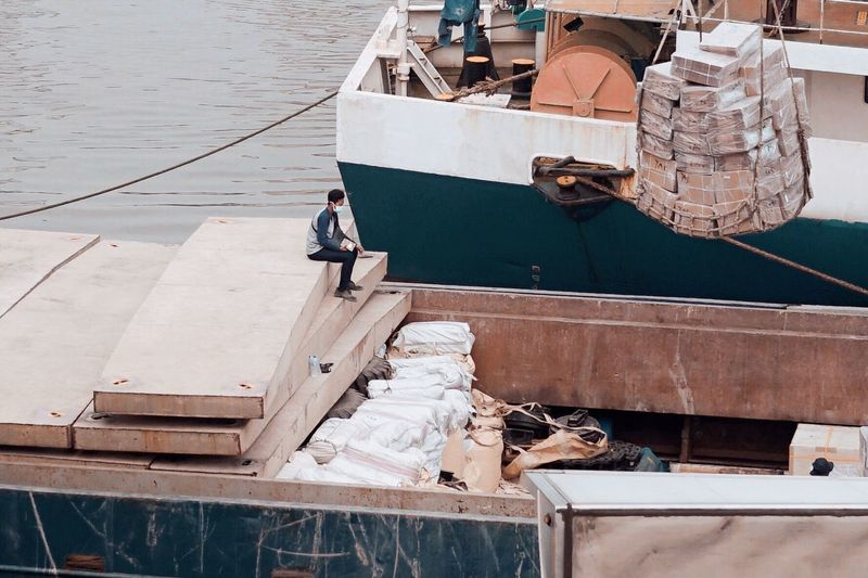 High angle view of man working on boat