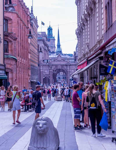 Stockholm Streetphotography Architecture Building Exterior Built Structure Group Of People Crowd Large Group Of People Real People City Women Building Adult Street Tourism Lifestyles Spirituality Religion Day Outdoors