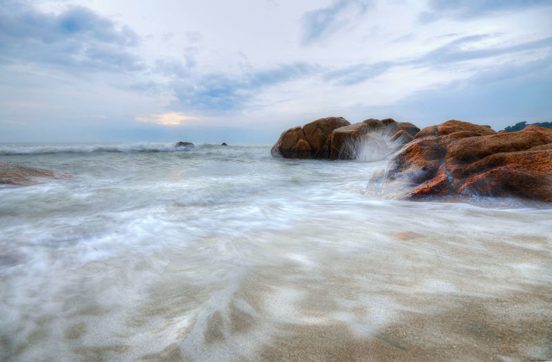 long exposure motion of waves at beach Wave Water Sea Beach Sand UnderSea Sky Horizon Over Water Cloud - Sky Landscape Seascape Surf Flowing Water