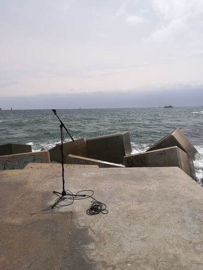 When the wind is singing Life What I See WhyNot? Openmic Microphone Alone Beach Sea Land Sky Water Nature Tranquility Beauty In Nature Scenics - Nature Sand Horizon Over Water Outdoors Horizon No People Architecture Cloud - Sky Day Tranquil Scene Travel Destinations