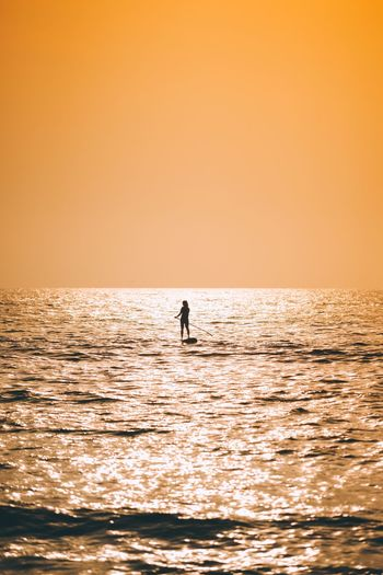Alone Netherlands Holland Travel Destinations Travel Sunset Silhouettes Water Sea Horizon Over Water Sky Horizon Beauty In Nature Waterfront Silhouette Sunset Scenics - Nature Clear Sky Orange Color Copy Space Real People Nature One Person Idyllic Leisure Activity Tranquility Outdoors