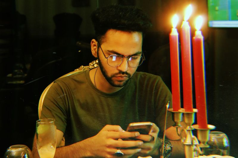 digital era running business on phones Businessman Business Person Communication Illuminated Eyeglasses  Human Hand Flame Front View Portrait Burning Headshot Candle Men Candlelight Bonfire Lit