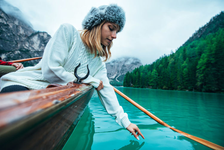 Full length of woman on lake against trees