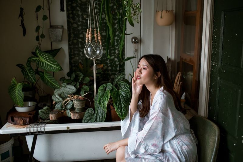 Daydreaming Looking Away Portrait Photography Portrait Of A Woman Plants Bathtub One Person Young Adult Sitting Adult Plant Hair Brown Hair Beautiful Woman Young Women Beauty Contemplation Side View My Best Photo