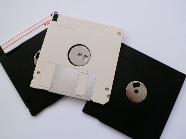 No People Man Made Object Circle Full Frame Studio Shot Indoors  Differential Focus Communication White Background Disc Eye4photography  EyeEm Gallery White Color Backgrounds High Angle View Close-up Office Supply Technology Background Floppy Disc Hello World EyeEm Best Shots Geometric Shape Office