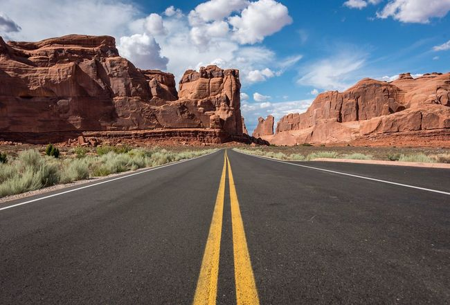 Awesome Arches Nationalpark Nikon Road The Way Forward Marking Direction Sign Road Marking Transportation Sky Cloud - Sky Nature Empty Road No People Diminishing Perspective Asphalt Double Yellow Line Scenics - Nature Dividing Line Day Country Symbol