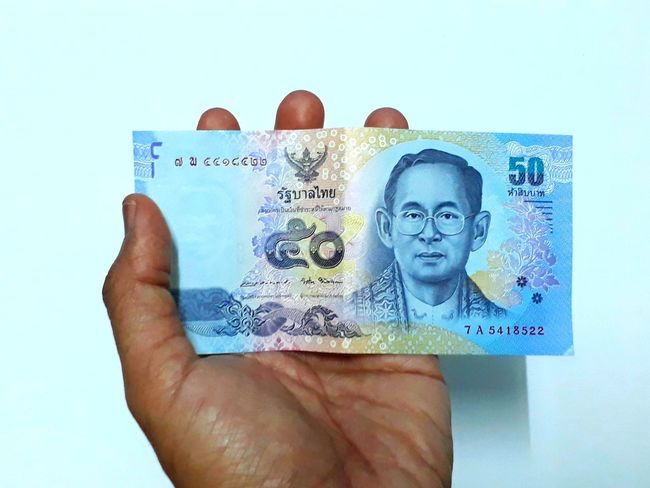 Fiftise Thai banknote. Finance EyeEm Best Shots Eyeemfirstphoto EyeEmNewHere Eyeemfirstphotography EyeEm Selects Fifty Hand Rich Dollar Bill Bussiness Thai Banknote Human Body Part Human Hand One Person Colored Background Men Only Men Business