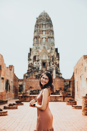 Tourist woman in brown dress at wat ratchaburana temple, ayutthaya, thailand