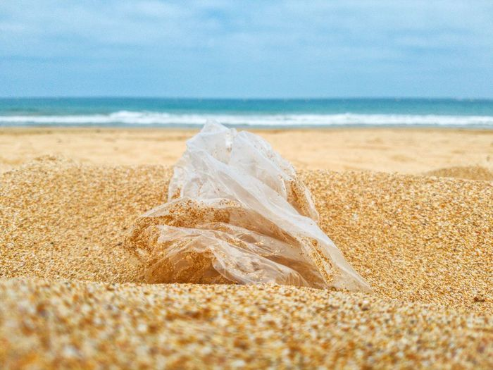 Close-up of a plastic bag  on beach
