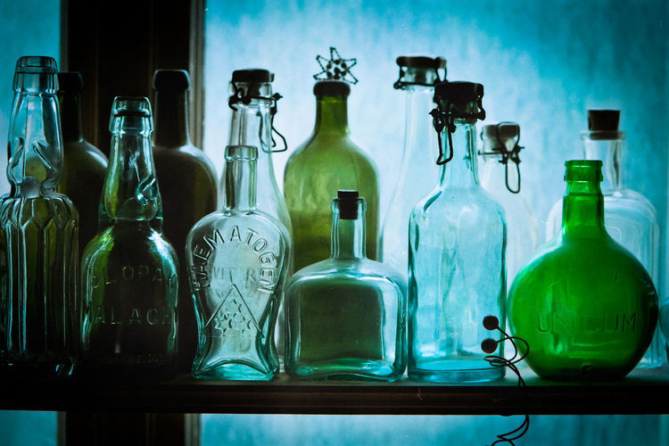 Bottles Alcohol Antique Antique Glass Backlight Blue Glass Bottle Drinking Glass Glass Glass - Material Glass Art Green Color Green Glass Group Of Objects Indoors  Laboratory Liqueur Old Bottle Retro Bottles Retro Glass Retro Style Shelf