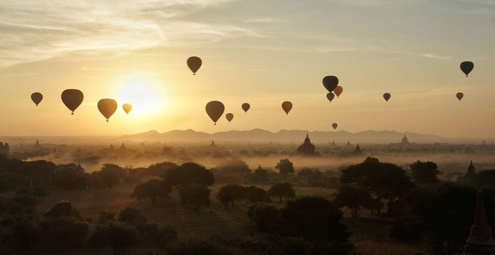Silhouette Of Hot Air Balloons Flying In Sky