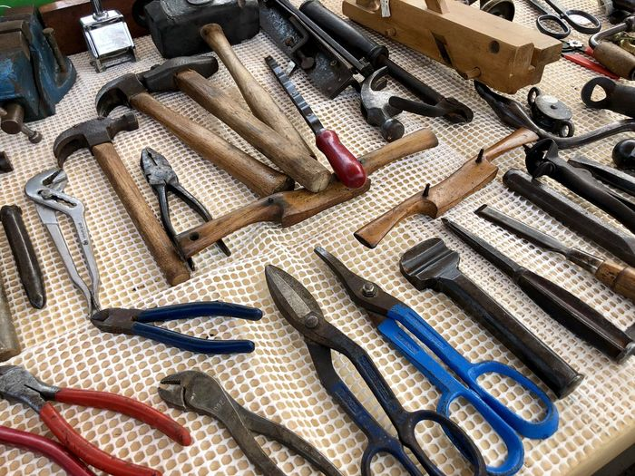 High angle view of tools on table in workshop