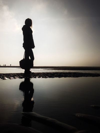 Silhouette of woman in sea
