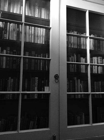 The doors to Heaven? Black & White IPhoneography Lines Blackandwhite Bookstore Light And Shadow Creative Light And Shadow Books What I Value Bookshelf