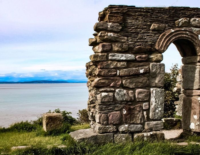 Travel Destinations Sky Day Water Built Structure Architecture Cloud - Sky Outdoors Tourism Travel Nature Old Ruin No People Sea Beauty In Nature Horizon Over Water Grass Ancient Civilization Lancashire UK Heysham Coast