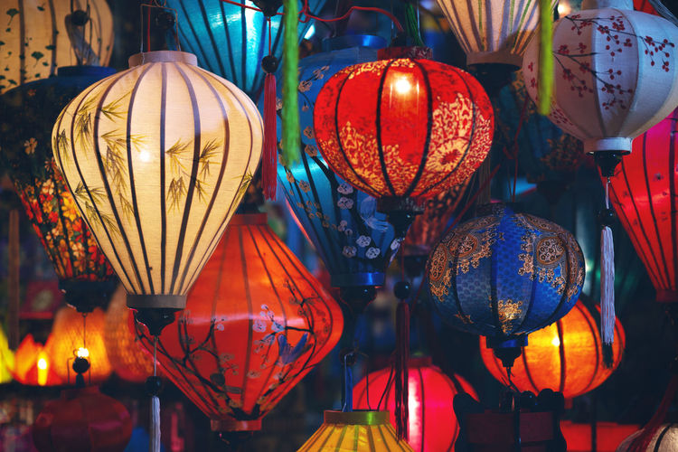 Low angle view of illuminated lanterns hanging in market at night