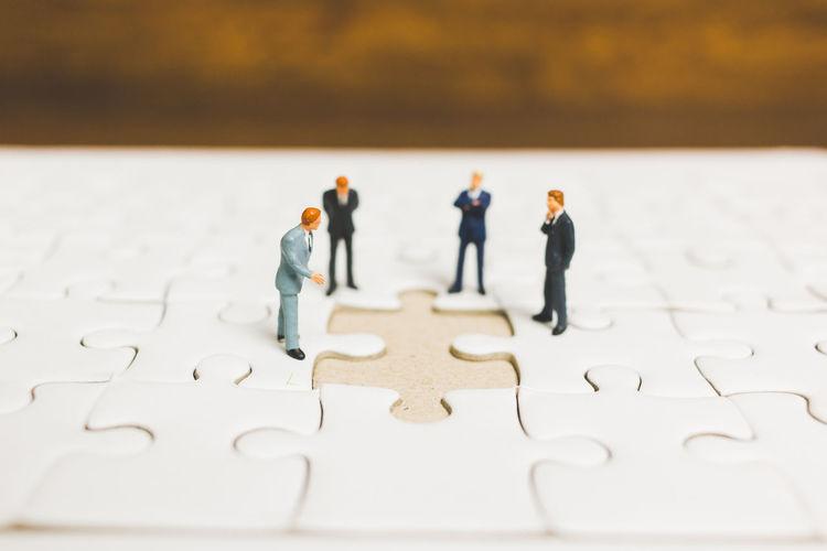 Business Figure Growing Man Businessman Concept Connection Contract Deal Finance Financial Jigsaw Piece Jigsaw Puzzle Marketing Mini Miniatur Wunderland Miniature People Model Money People Puzzle  Solution Success Teamwork Wealth