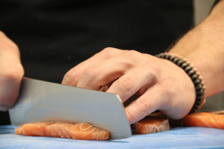 Human Body Part Human Hand Close-up Only Men Working Indoors  Fish Salmon Sashimi Knife Cutting Board Blue Black Food Stories