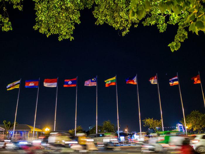 Cars on illuminated street lights in city at night