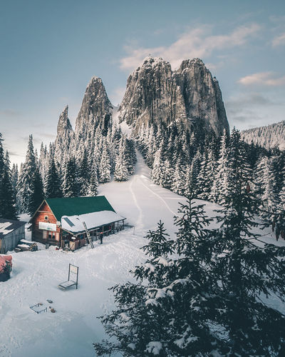 Architecture Beauty In Nature Building Building Exterior Built Structure Cold Temperature Cottage Covering Day House Mountain Nature No People Outdoors Plant Scenics - Nature Sky Snow Snowcapped Mountain Tranquil Scene Tranquility Tree Winter