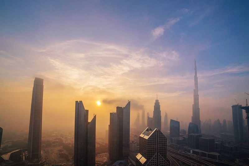 City of dreams Burjkhalifa Landscape_photography Photographer Passionatephotography Indian Dubaiphotographer Dream Goldenhour Sunrise Sky Architecture Building Exterior City Built Structure Office Building Exterior Skyscraper Cityscape Building Urban Skyline Nature Cloud - Sky Landscape Travel Destinations Tall - High Tower City Life Modern No People