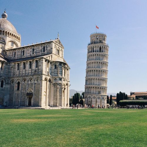 Low angle view of leaning tower of pisa against sky
