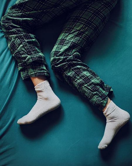Low section of  sleeping legs with socks