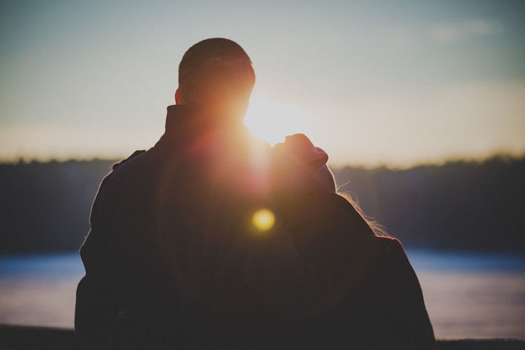 Back Lit Couple Focus On Foreground Lens Flare Love Majestic Men Mountain Nature Non-urban Scene Outdoors Rear View Relaxation Sea Sky Solitude Sun Sunbeam Sunlight Sunny Sunset Tranquil Scene Tranquility Vacations Vibrant Color