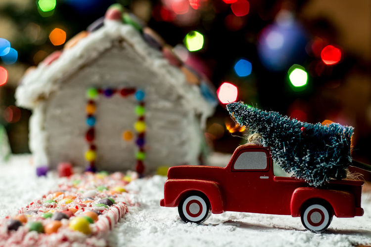 Close-up of toy car on christmas tree during winter