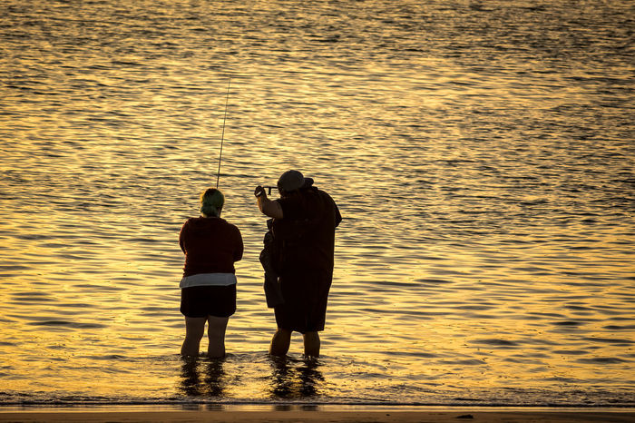 """""""Hold this, Babe."""" California Couple Couple Fishing Fishing Golden Sunlight Sunlight Reflection Sunset Sunset Porn Sunset Silhouettes Sunset_collection Togetherness Ventura Ventura Beach VenturaCounty Water"""