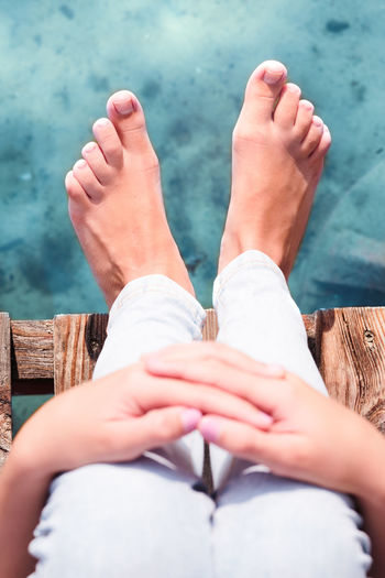 Close shot from above of female legs on jetty over the lake on sunny day in the summertime Moments Recreation  Relaxing Summertime Vacation Time Vacations Above Close-up Feet Girl Human Body Part Human Leg Joy Joy Of Life Lake Leisure Leisure Activity Lifestyles Outdoors Real People Recreational Pursuit Relaxing Time Summer Summer Vibes Water