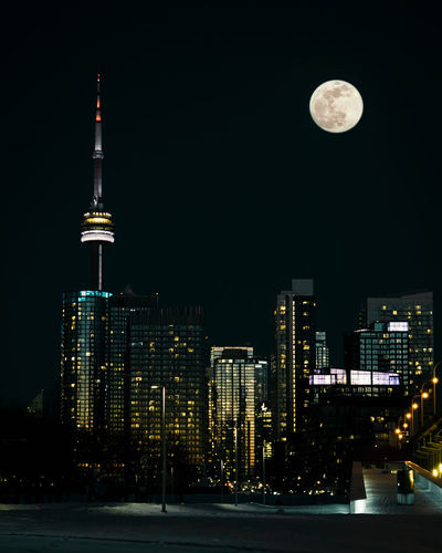 Toronto Downtown EyeEm Best Shots EyeEmNewHere EyeEm Nature Lover EyeEm Selects EyeEm Gallery Nikon D750 Concept Conceptual Focus On Background Sharp Dark Photography Moon Surface Tripod Toronto Ontario Canada Canadian Best  Fresh New Financial District  Moonlight Urban Skyline Outdoors No People Full Moon Travel Destinations Cityscape Night Building Exterior Architecture Built Structure City Moon Illuminated Tall - High Sky Building Tower Office Building Exterior Skyscraper Modern Spire  Planetary Moon CN Tower Full Moon