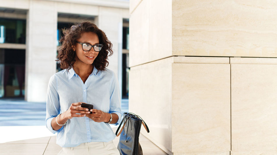 One Person Standing Real People Business Woman Females African Outdoors Lifestyles Glasses Casual Clothing Day Technology Working Freelance Positive Professional Young Copy Space Modern Mobile