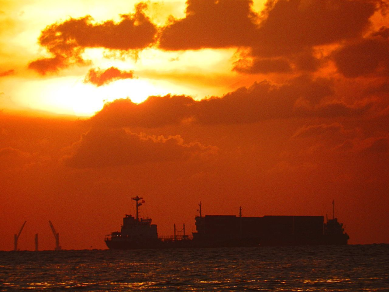 sunset, sea, orange color, nautical vessel, silhouette, sky, transportation, water, sun, waterfront, cloud - sky, freight transportation, mode of transport, industry, commercial dock, harbor, outdoors, nature, shipping, no people, crane - construction machinery, beauty in nature, scenics, travel destinations, building exterior, architecture, offshore platform, day, oil pump