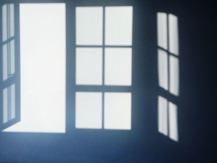 Blue wall with window shadows Window Indoors  Shadow Day Looking Through Window No People Close-up Architecture