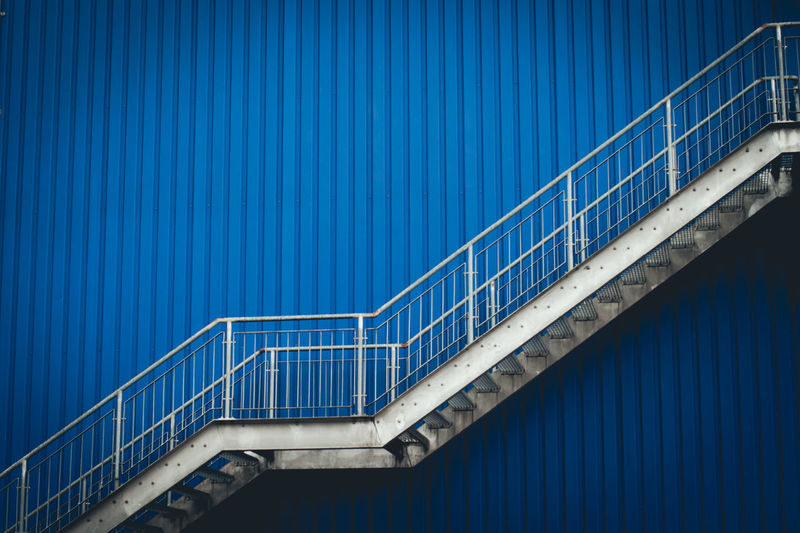 Low angle view of staircase against blue wall