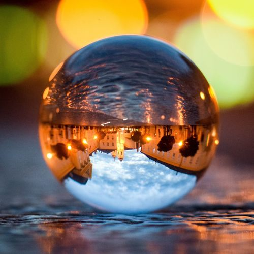 Close-up of illuminated crystal ball in water