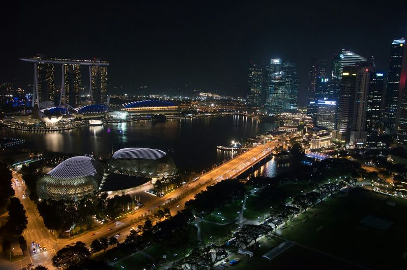 Illuminated Marina Bay Sands And Modern Buildings In City At Night