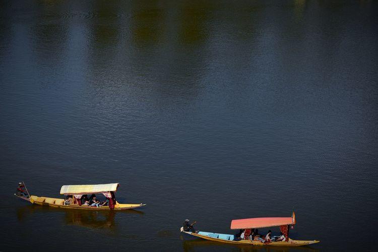 High angle view of people sailing on lake