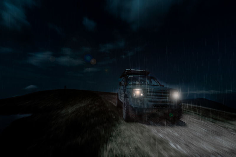 Off road through the night Car Cloud - Sky Disco Discovery Headlight Illuminated Land Rover Landscape Night No People Outdoors Overland Sky Sunset Tent Travel