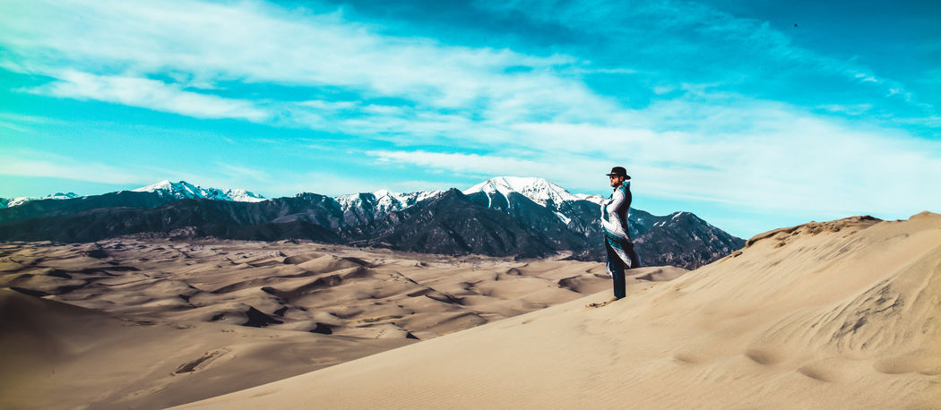 Adventure Beauty In Nature Day Full Length Landscape Leisure Activity Men Mountain Nature One Person Outdoors Physical Geography Real People Sanddunes Scenics Sky Standing Tranquil Scene