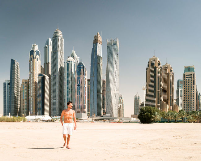 One Man Only Only Men Skyscraper Sand Adults Only Beach One Person City Vacations Adult Urban Skyline Outdoors Sea People Cityscape Men Full Length Sky Day Architecture Travel Destinations Dubai Dubaicity Dubai Marina Dubailife Been There. Done That. Connected By Travel