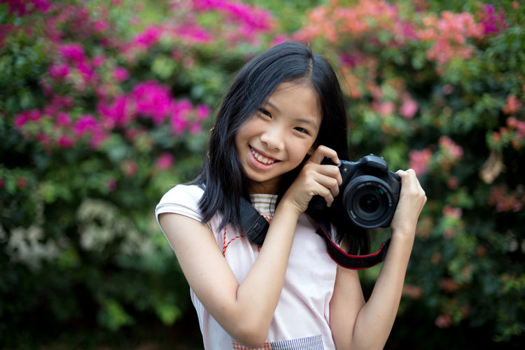 Girl Photographer Adult Asian  Background Beauty Camera - Photographic Equipment Cheerful Child China Chinese Day Flower Girl Happiness Happy Nature One Person Outdoors People Photographer Photography Themes Portrait Portraits Smiling Summer Thai The Portraitist - 2018 EyeEm Awards