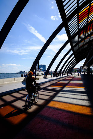 Amsterdam Architecture The Week on EyeEm Architecture Bicycle Building Exterior Built Structure Centraal Station City Cloud - Sky Cycling Day Full Length Land Vehicle Mode Of Transportation Nature One Person Outdoors Real People Riding Shadow Sky Sunlight Transportation Travel #FREIHEITBERLIN
