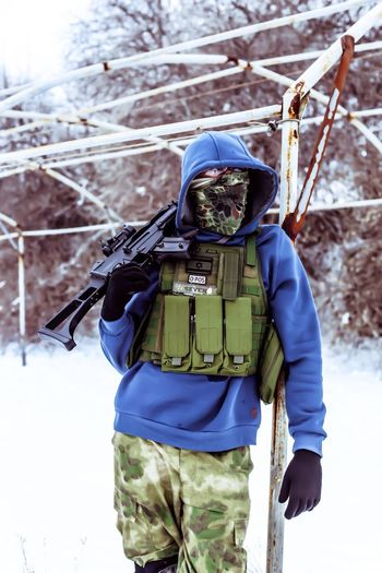 Portrait of airsoft player in winter