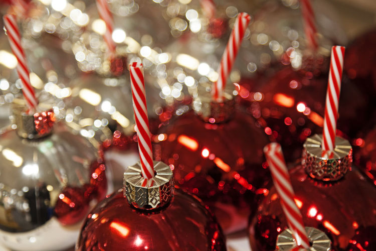 Red and silver colored christmas balls with candy canes