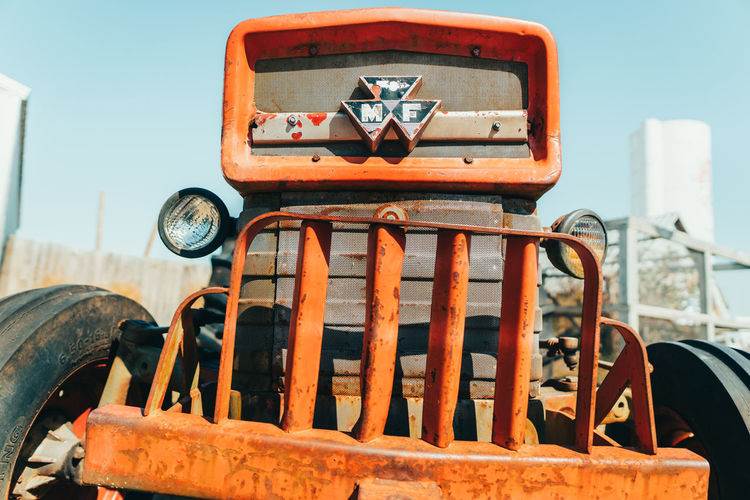 Close-up of old abandoned truck against sky